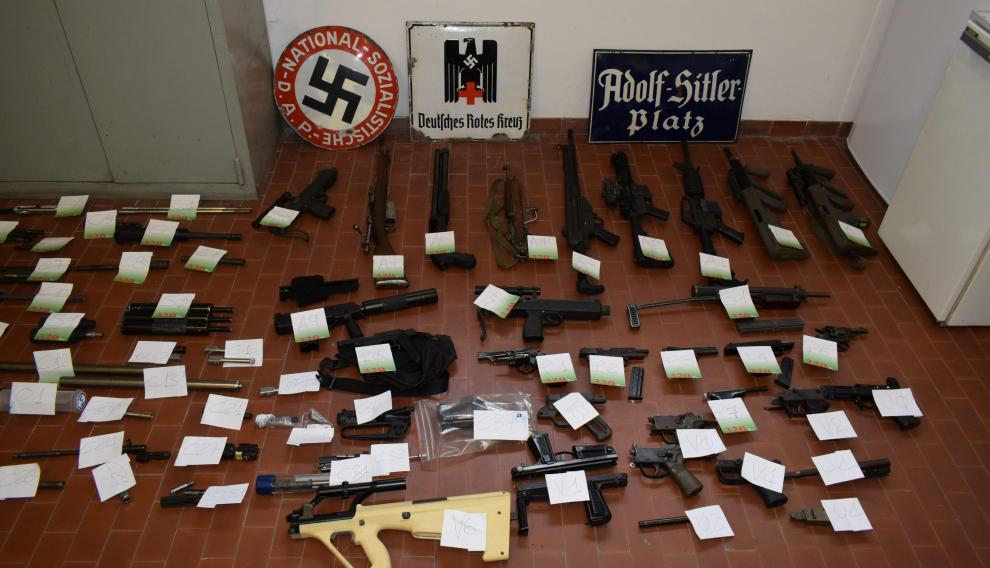 Italian Police handout shows a large arsenal of weapons, including an air-to-air missile, that they say they seized in raids on neo-Nazi sympathisers, in Turin, Italy July 15, 2019. Polizia di Stato/Handout via REUTERS   ATTENTION EDITORS - THIS IMAGE HAS BEEN SUPPLIED BY A THIRD PARTY. [[[REUTERS VOCENTO]]] ITALY-NEONAZI/ARMS