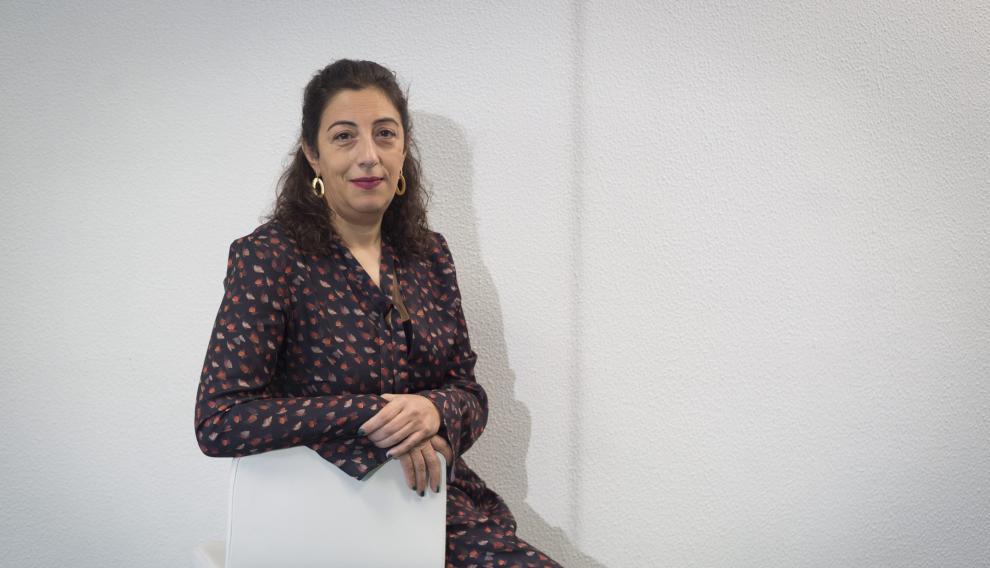 María Frisa.