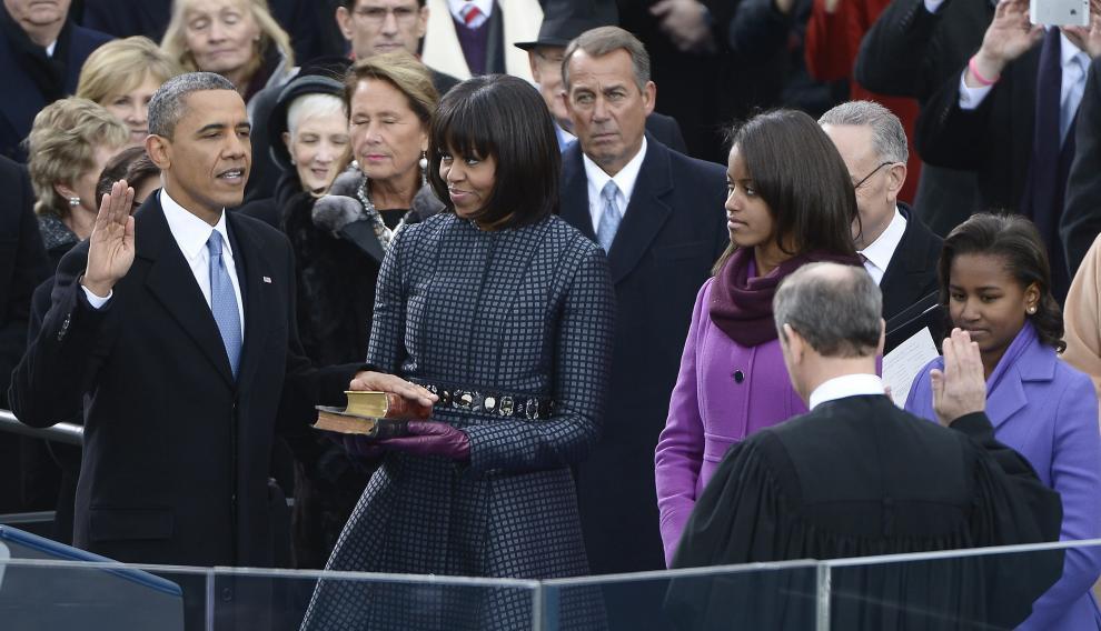 Michelle Obama, con un abrigo de Thom Browne, en la toma de posesión de su marido como presidente de los Estados Unidos en 2013
