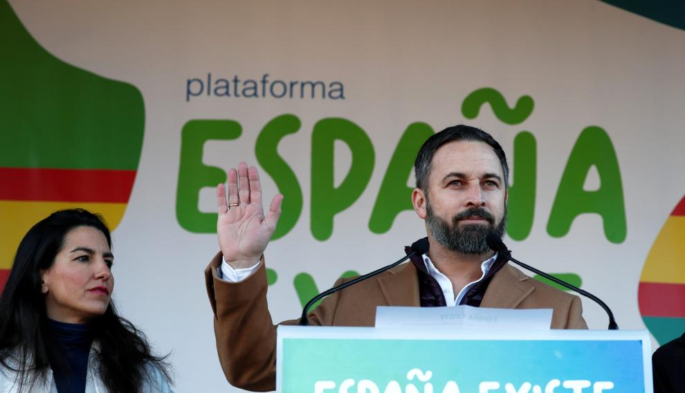 Santiago Abascal, leader of the far-right party VOX, speaks next to Madrid's regional Vox leader Rocio Monasterio, during a rally in protest against the new coalition government led by Spain's Prime Minister Pedro Sanchez, at Cibeles Square in Madrid, Spain, January 12, 2020. REUTERS/Jon Nazca [[[REUTERS VOCENTO]]] SPAIN-POLITICS/PROTEST
