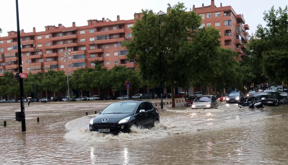Streets flooded by the storm next to the North Station of Zaragoza