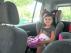 La pequeña Marina, lista para viajar bien sujeta en su silla.