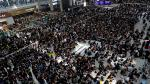 REFILE - CORRECTING GRAMMAR Anti-extradition bill protesters attend a mass demonstration after a woman was shot in the eye during a protest at Hong Kong International Airport, in Hong Kong, China August 12, 2019. REUTERS/Tyrone Siu [[[REUTERS VOCENTO]]] HONGKONG-PROTESTS/
