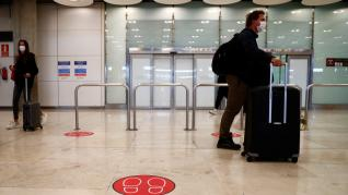 Passengers arrive at Adolfo Suarez Barajas airport in Madrid