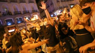 People celebrate as the state of emergency decreed by the Spanish Government to prevent the spread of the coronavirus disease (COVID-19) gets lifted in Madrid