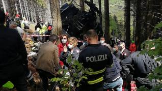 Police and rescue service members are seen near the crashed cable car after it collapsed in Stresa