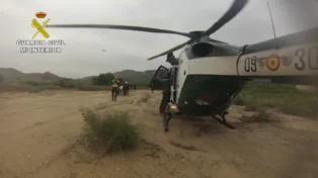 Momento del rescate del fallecido en Orihuela