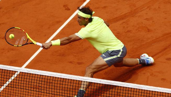 Nadal, en acción contra Federer.