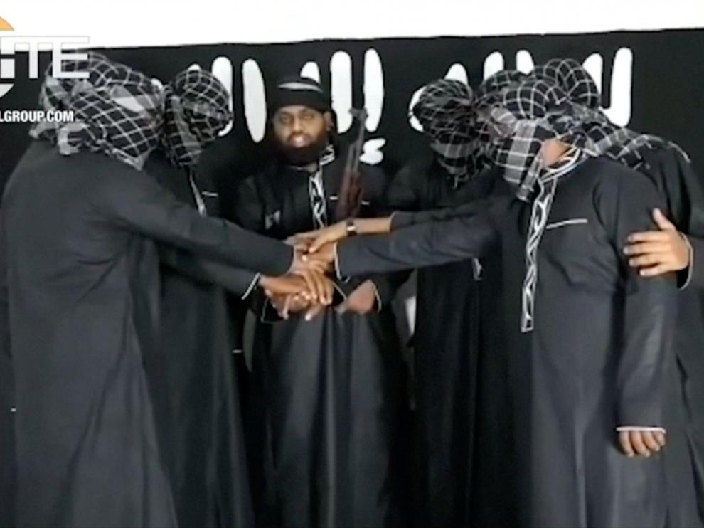 A group of men purported to be the the Sri Lanka bomb attackers is seen at an unknown location in this still image taken from video uploaded by the Islamic State's AMAQ news agency April 23, 2019 and received by Reuters via SITE Intel Group. Video uploaded April 23, 2019.  AMAQ via SITE INTEL GROUP/Handout via REUTERS TV    ATTENTION EDITORS - THIS IMAGE HAS BEEN SUPPLIED BY A THIRD PARTY. NO RESALES. NO ARCHIVES      TPX IMAGES OF THE DAY [[[REUTERS VOCENTO]]] SRI LANKA-BLASTS/
