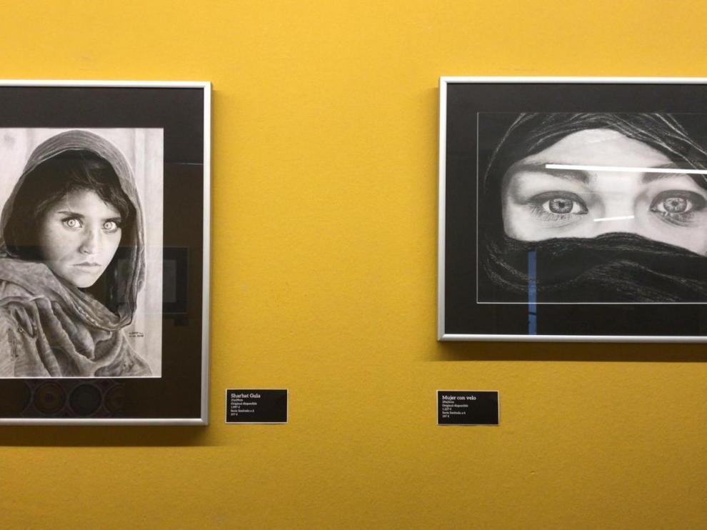 Dos de los dibujos de Albert Lluís expuestos en Impact Hub Zaragoza.