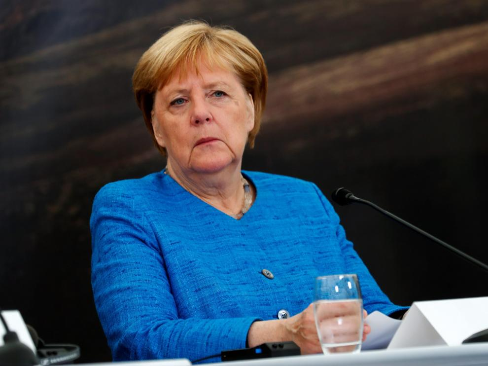 REFILE - ADDING INFORMATION German Chancellor Angela Merkel looks on at a news conference during the annual informal summer meeting of the Nordic prime ministers in Reykjavik, Iceland August 20, 2019. REUTERS/Ints Kalnins [[[REUTERS VOCENTO]]] GERMANY-MERKEL/ICELAND