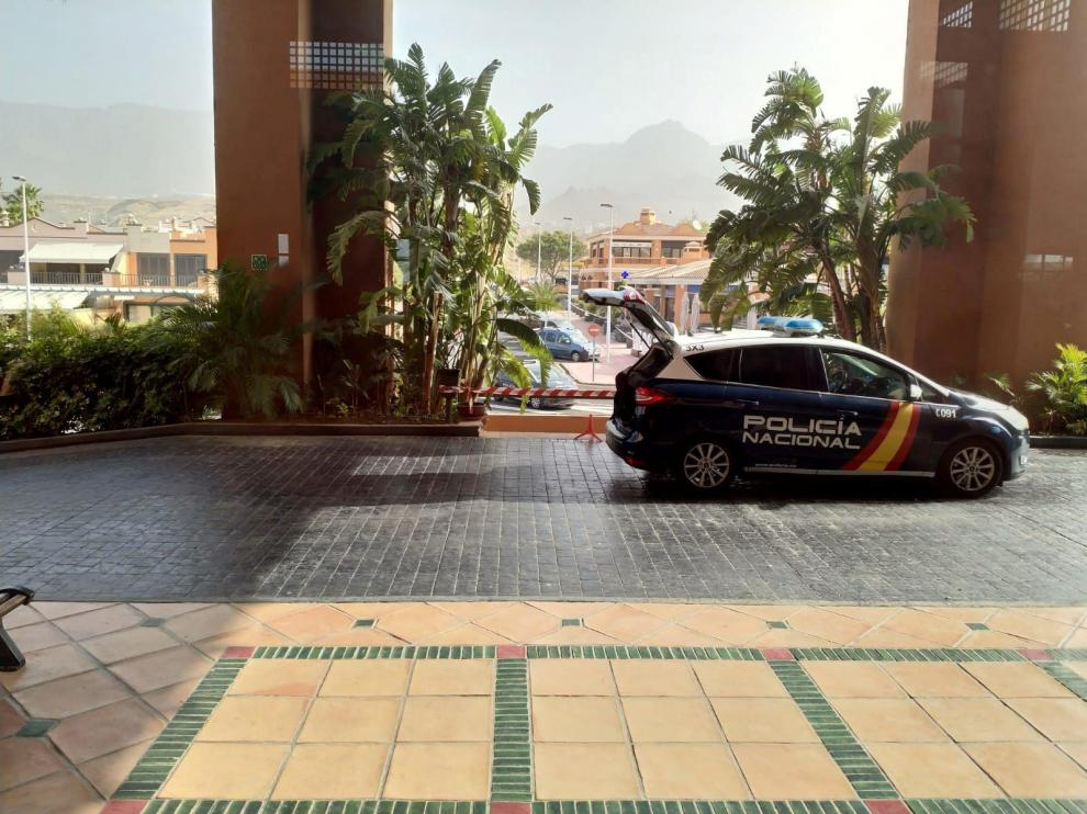 A Spanish National Police car is parked outside a hotel under lockdown after a coronavirus case was identified in Adeje