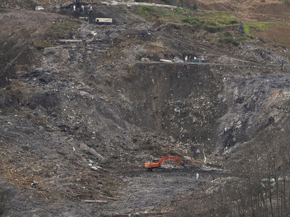 Los servicios de emergencias continúan el rescate de los cuerpos de los dos trabajadores sepultados