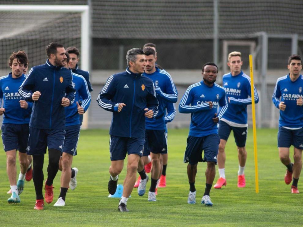 Los futbolistas del Real Zaragoza, en uno de los últimos entrenamientos ordinarios llevados a cabo en la Ciudad Deportiva antes del parón sine díe de la liga.