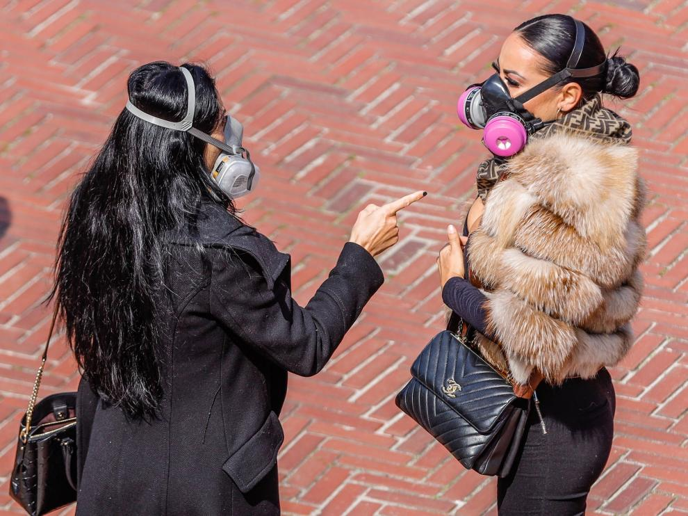 Dos mujeres con máscaras protectoras en Central Park, en Nueva York.