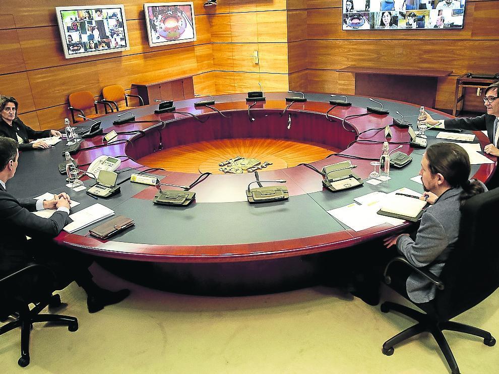 Teresa Ribera, Pedro Sánchez, Pablo Iglesias y Salvador Illa, este martes, en la reunión del Consejo de Ministros.