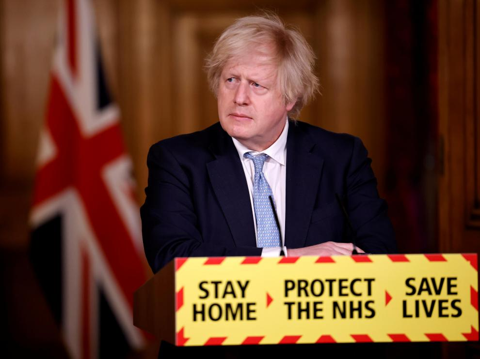 Britain's Prime Minister Boris Johnson gives an update on the COVID-19 pandemic during a virtual news conference, in London