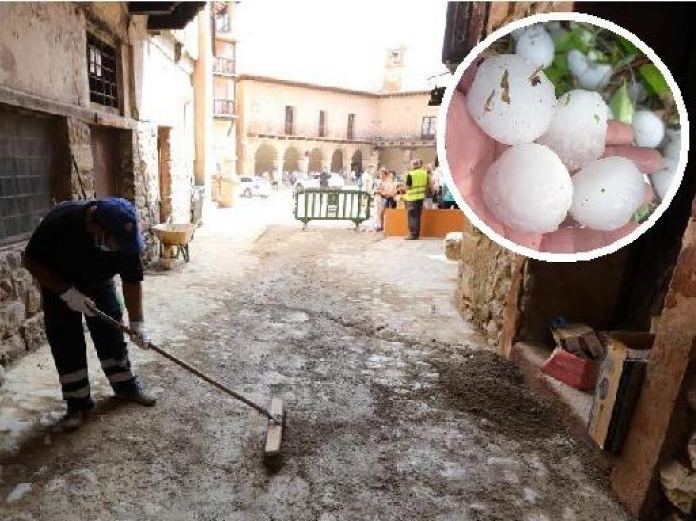 Operarios del Ayuntamiento de Albarración retiran barro de las calles que dejó la tormenta. Al lado, tamaño del granizo caído en Villel