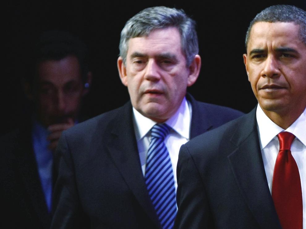 Sarkozy (i), Gordon (c) y Obama (d) antes de compadecer en la cumbre de G20, que se celebra en Pittsburgh, sobre la segunda planta de enriquecimiento de uranio que tiene Irán