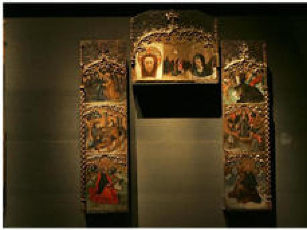 Retrablo de San Antonio Abad y caja sepulcral de Isabel de Aragón