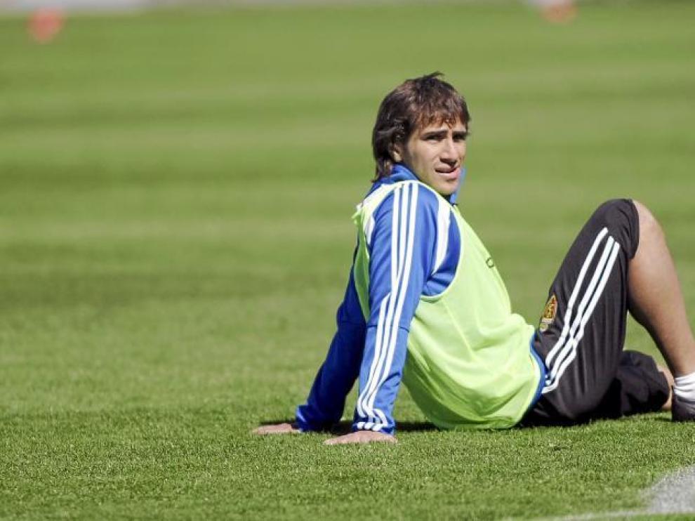Leo Ponzio, tumbado sobre el césped del campo de entrenamientos de la Ciudad Deportiva