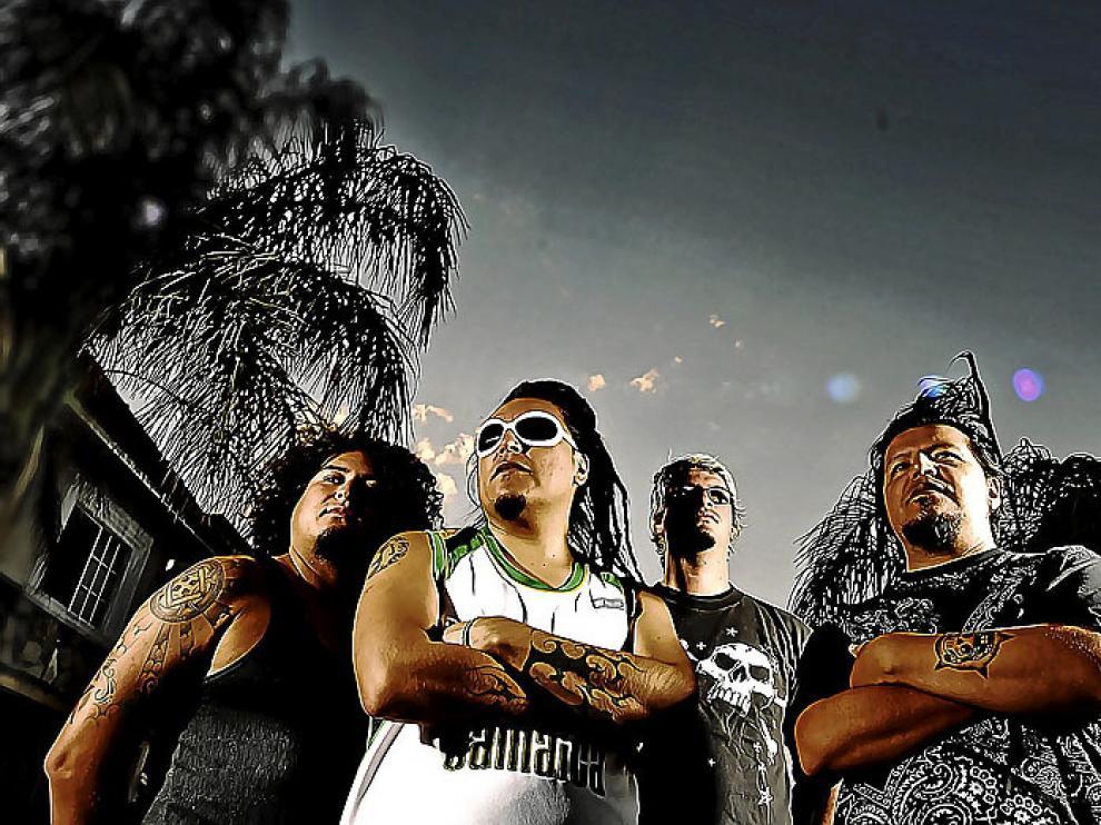 Cuatro de los integrantes del grupo mexicano El gran silencio