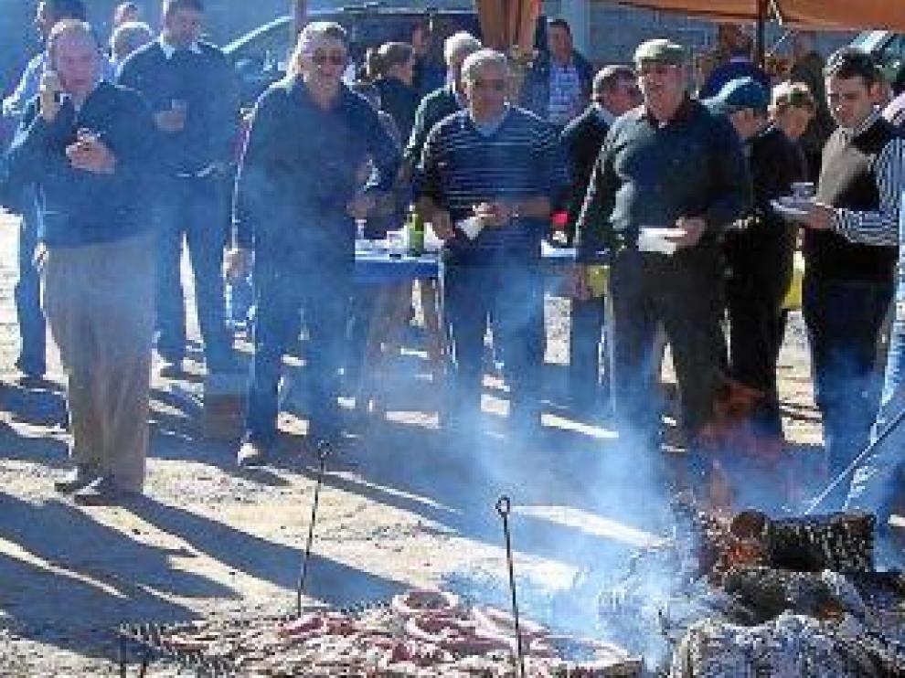 Hoguera de la Feria de San Martín para preparar la carne.