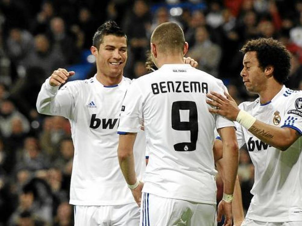 Benzemá, Cristiano Ronaldo y Marcelo, celebran un gol en una imagen de archivo.