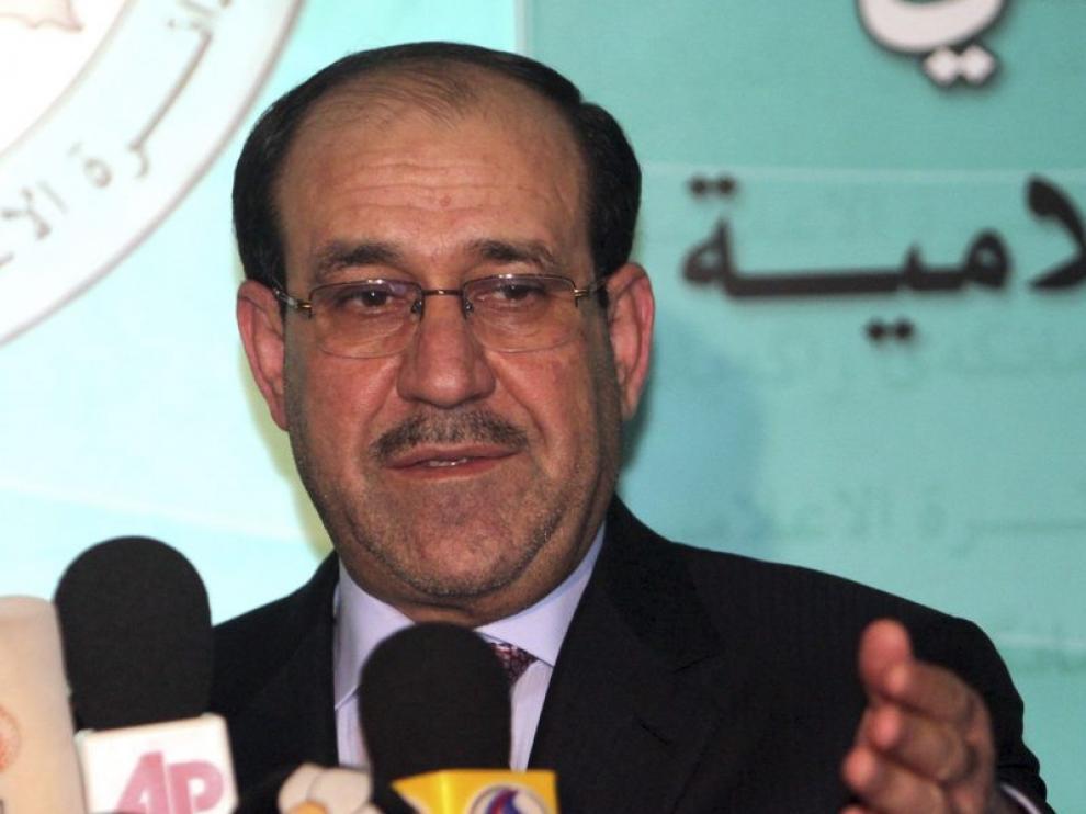 El primer ministro en funciones, Nuri al Maliki, atiende a la prensa, ayer en Bagdad