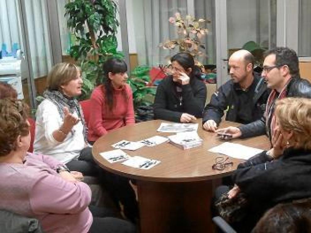 Imagen de la reunión entre Afammer y los comerciantes.