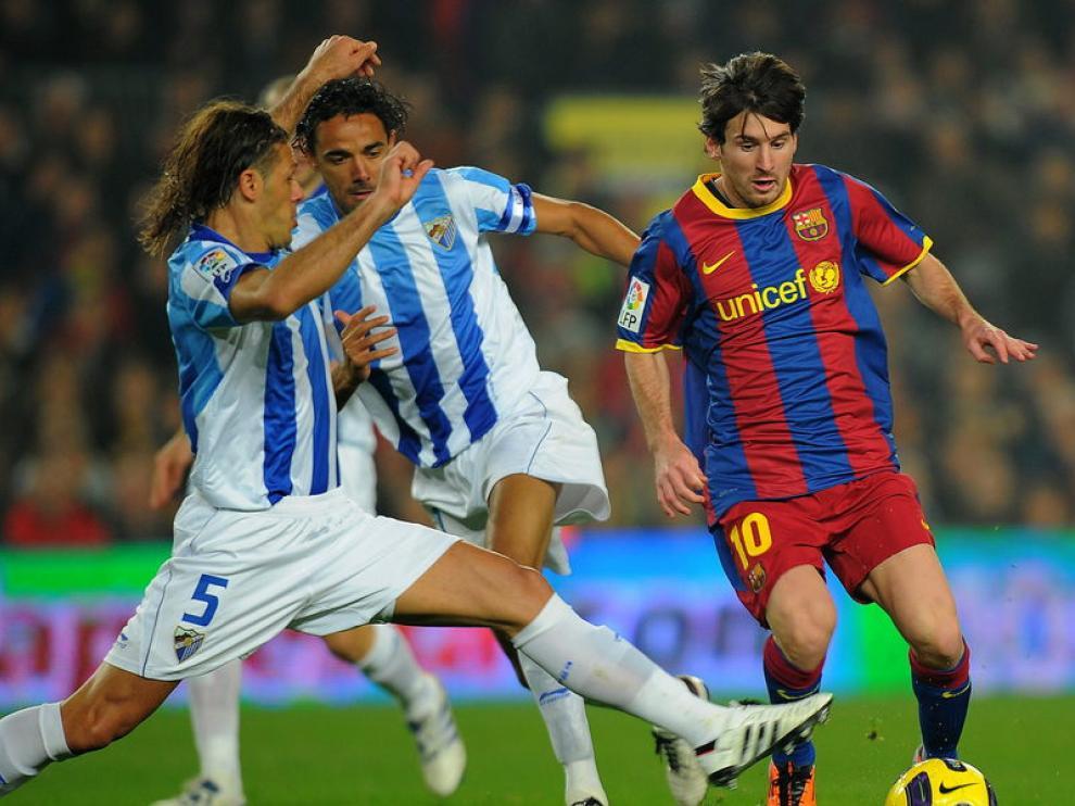 Messi se marcha de Demichelis en el encuentro ante el Málaga, el domingo pasado