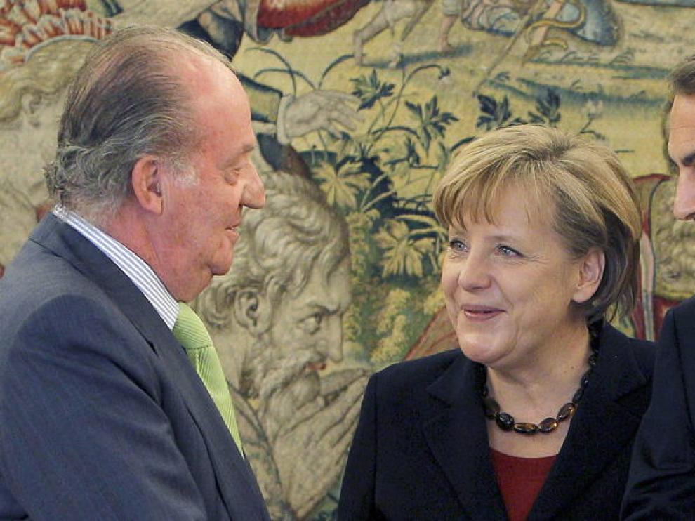 Angela Merkel, junto a José Luis Rodríguez Zapatero y el Rey