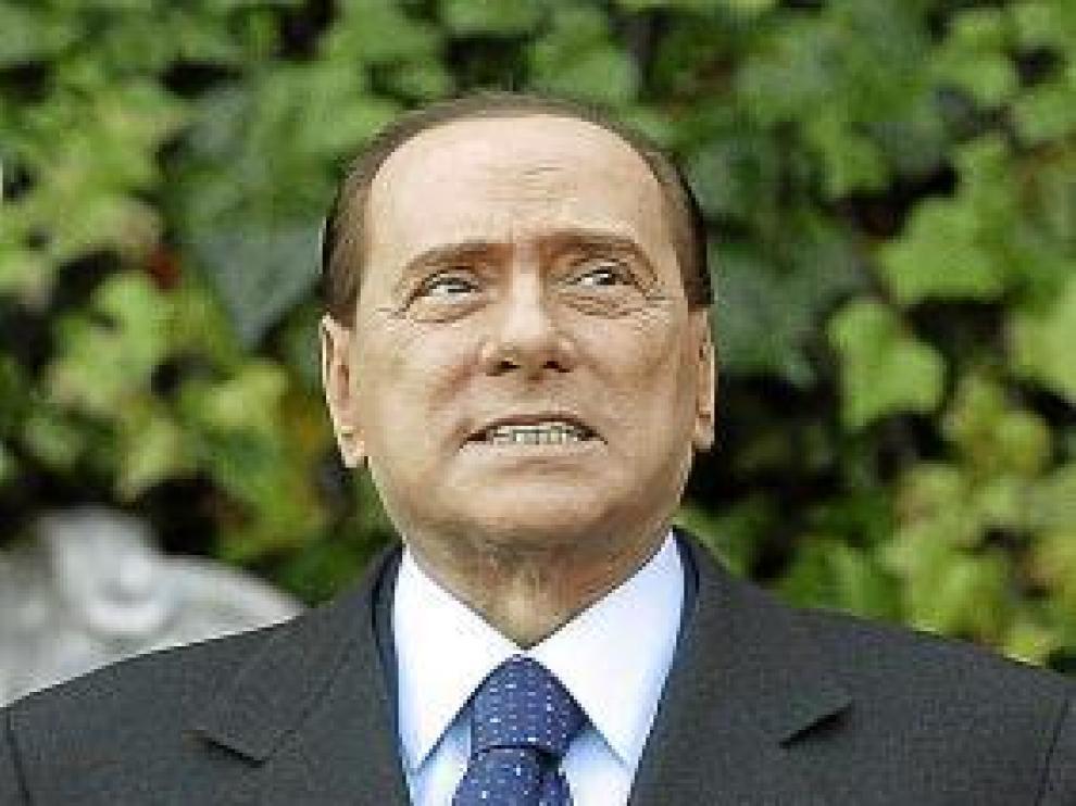 Fotos de archivo del primer ministro italiano y de la joven Ruby.