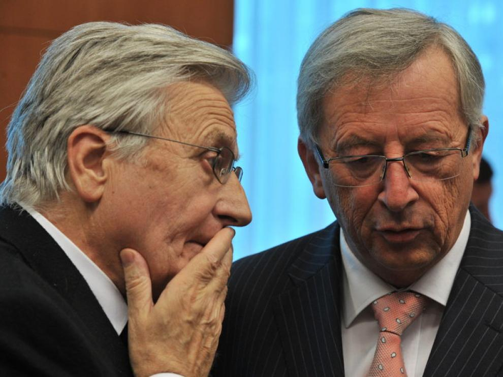 Trichet, presidente del BCE (izquierda) y Juncker, del Eurogrupo, el martes en Bruselas.