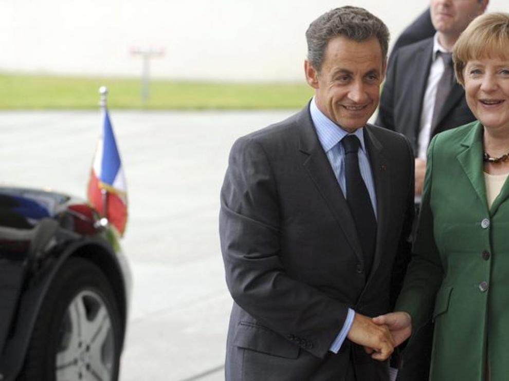 El persidente francés y la canciller alemana en una reunión bilateral por los preparativos de la cumbre de la Eurozona