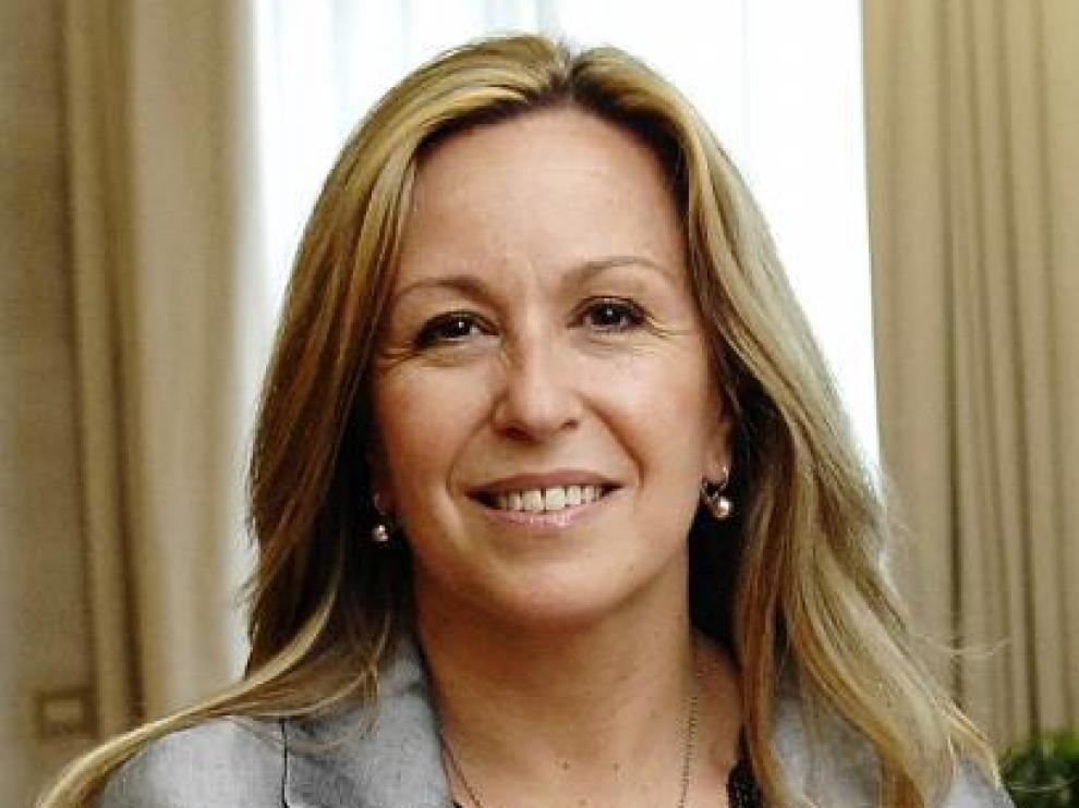 La ministra dice que su sonrisa es fruto de su optimismo.