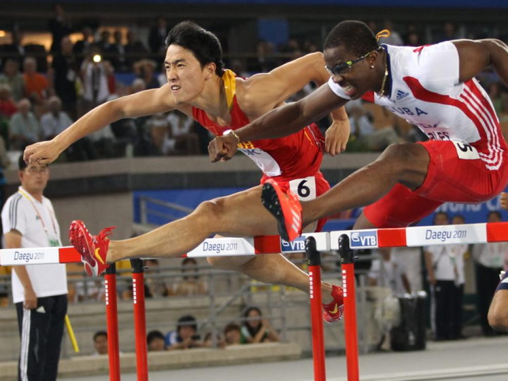 Liu Xiang y Dayron Robles, durante la prueba