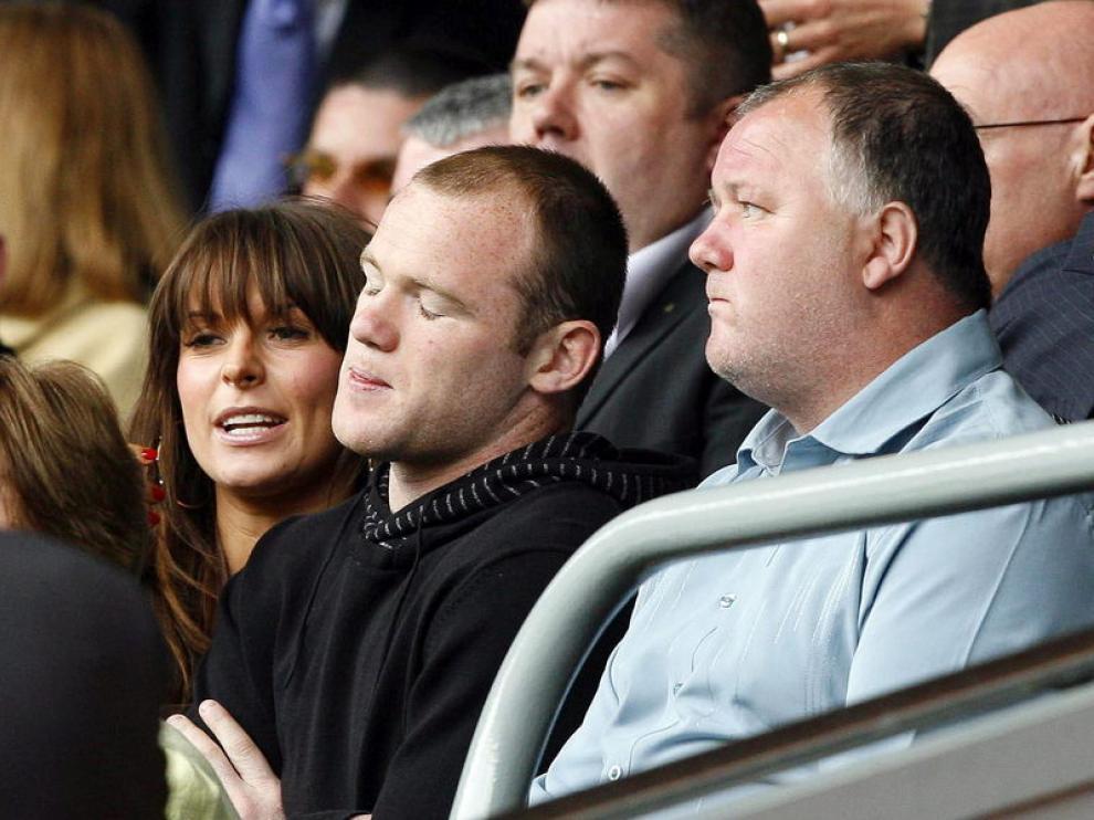 Wayne Rooney junto a su padre