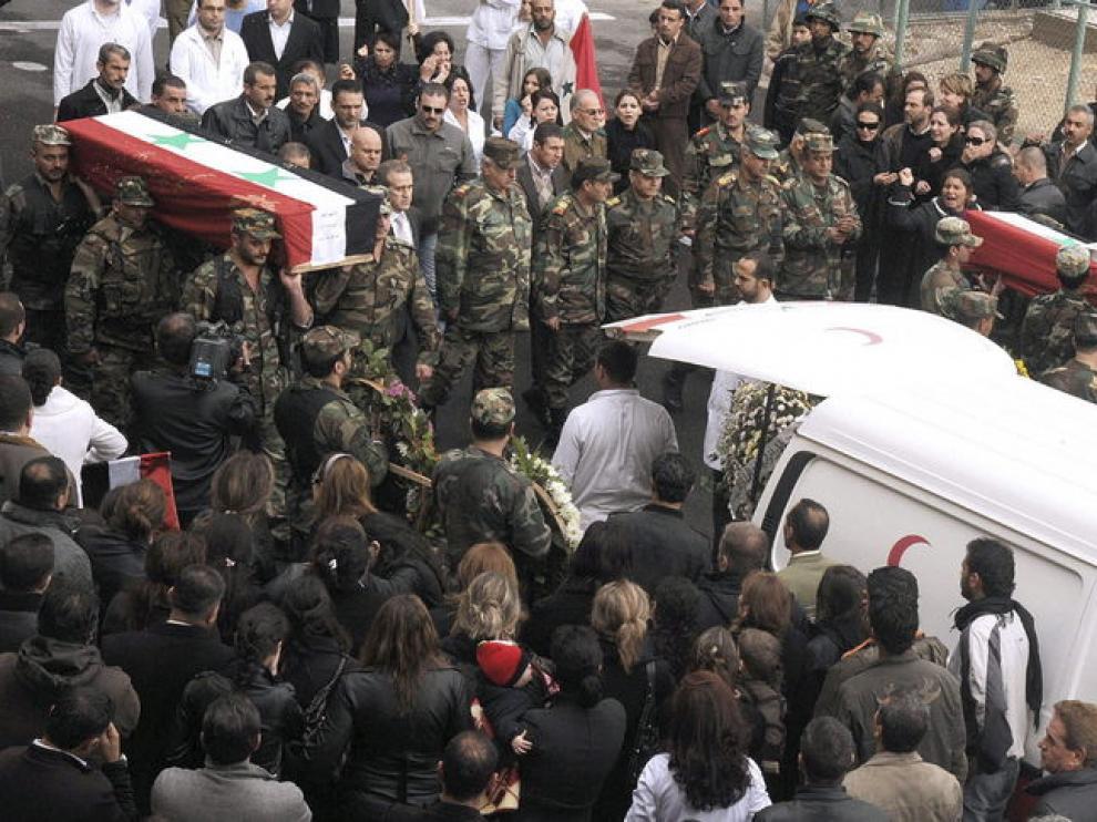 Funeral de policías en Damasco