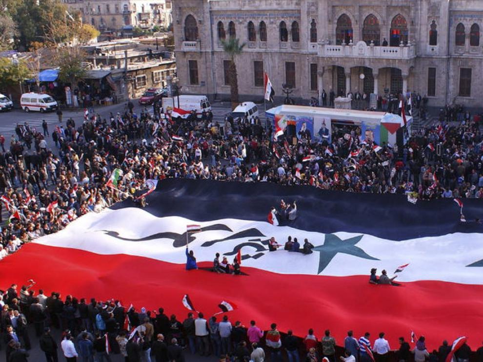 Partidarios de Bachar al Asad se manifiestan contra la Liga Árabe
