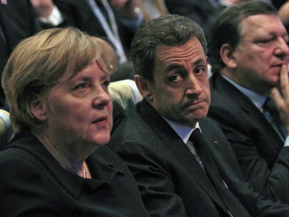 Angela Merkel y Nicolás Sarkozy, durante el Congreso del PPE