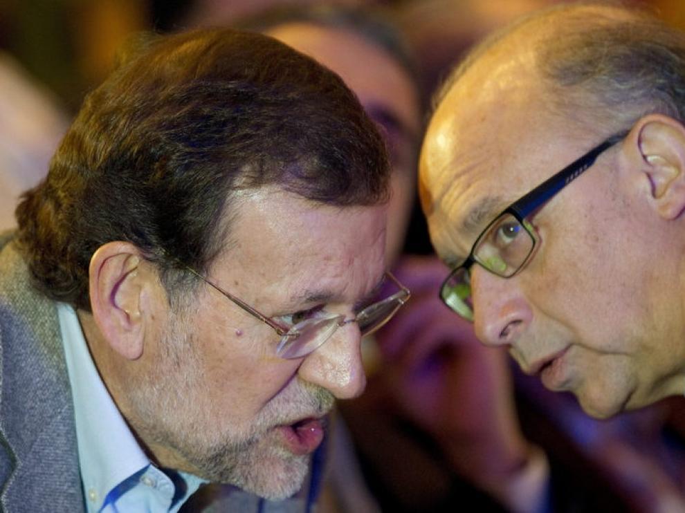 Rajoy y Montoro durante la convención autonómica del PP en Málaga.