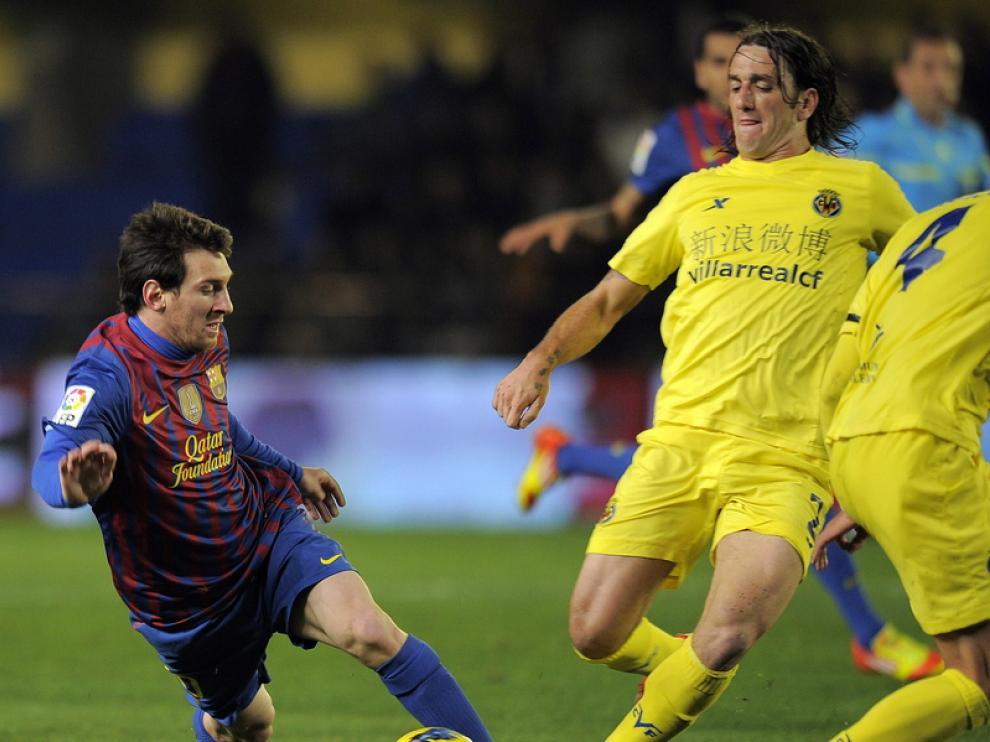 Messi y Rodríguez en una jugada del partido