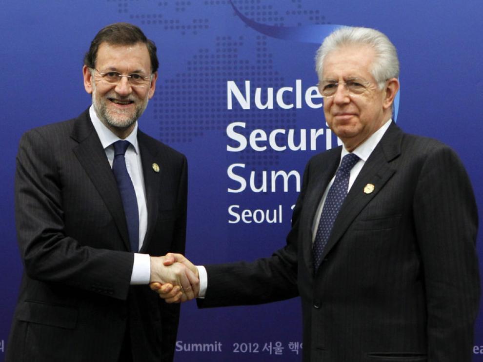 Rajoy y Mario Monti en Seúl