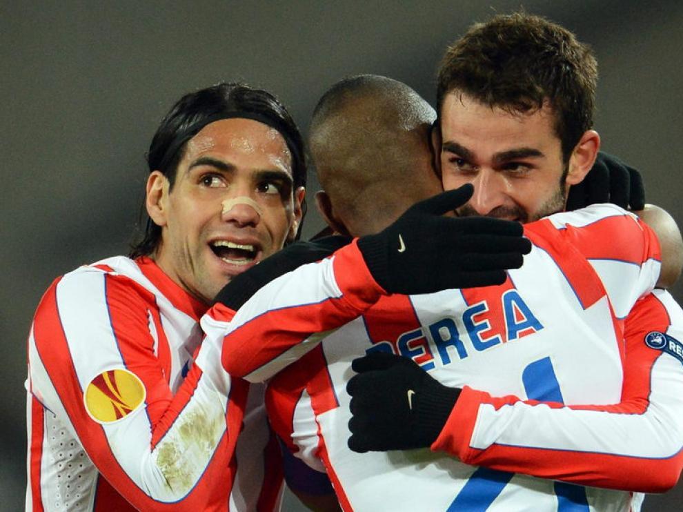 Jugadores del Atlético de Madrid celebran la victoria