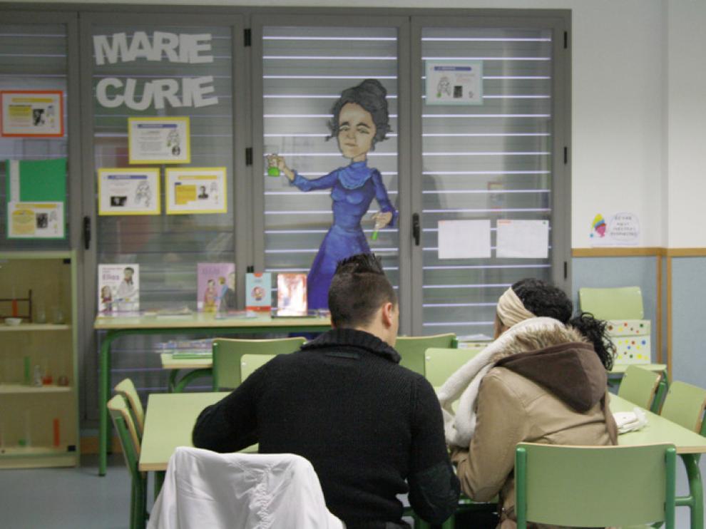 Padres en el Marie Curie, rellenando una solicitud
