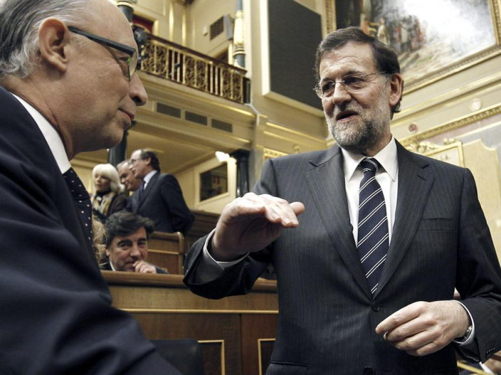 Rajoy y Montoro, durante la sesión en el Congreso