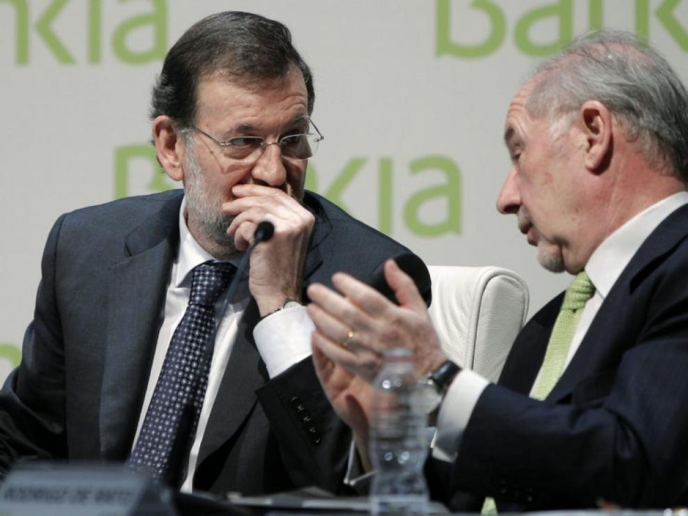 Rajoy y Rato en un encuentro en marzo