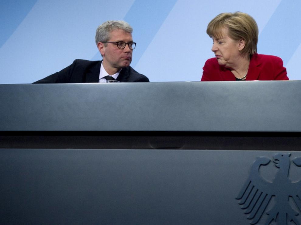 Angela Merkel junto al ministro cesado