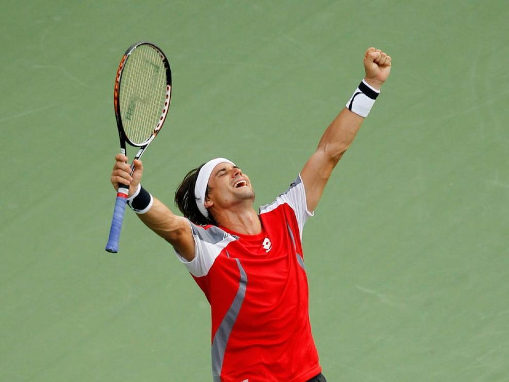 Ferrer celebra su victoria ante Tipsarevic